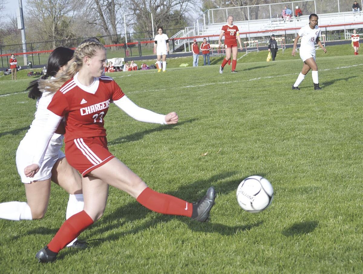 #23 Hannah Schlutz kicking ball. downfield.tif