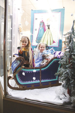 Frozen characters Elsa and Anna in Cindy Lou's Quilt Shop Window