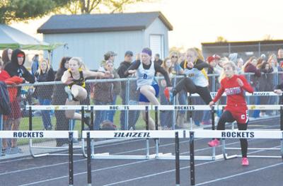 Emma Cochran running in the hurdles