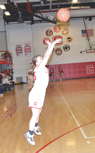 Abby Tuttle shoots a three-pointer