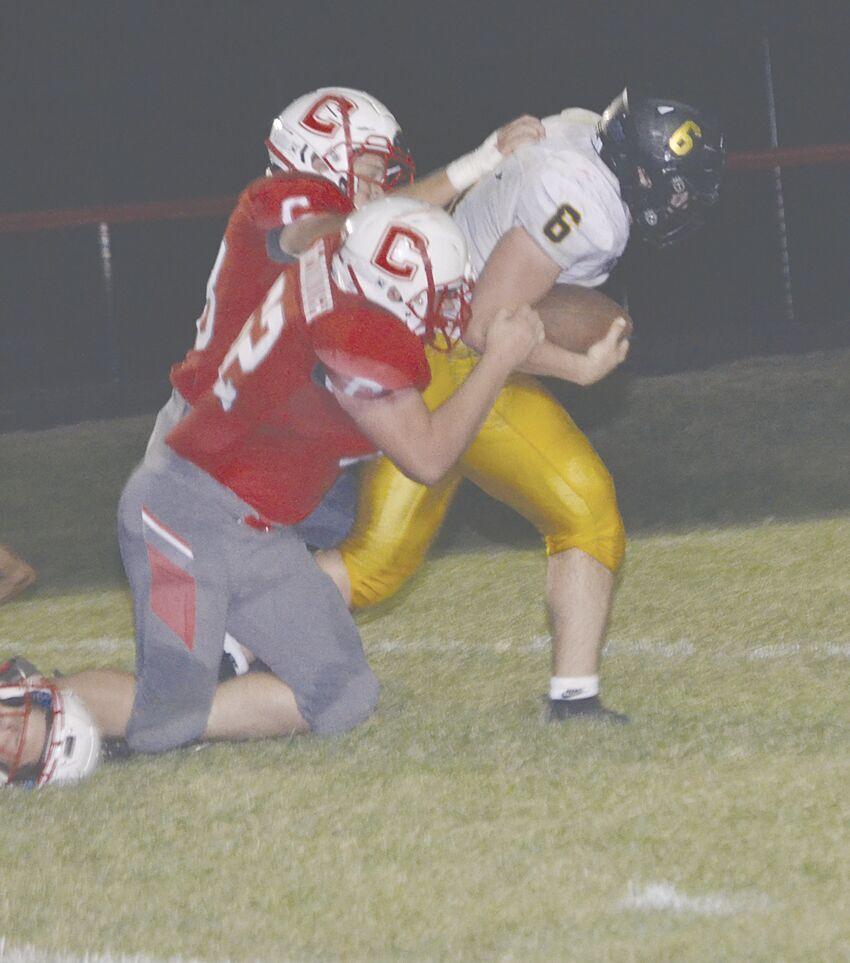 JR McDonough making tackle on ball carrier.tif