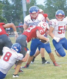 Varsity Chargers lose to Interstate 35 in football season opener