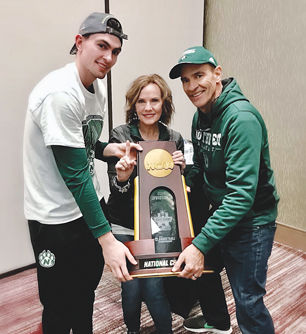 Daric Laing and his parents hold the NCAA Division II National Championship trophy