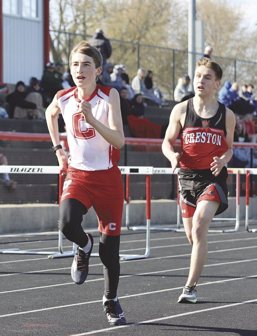 Connor Dixson sprinting to finish line in 3200.tif