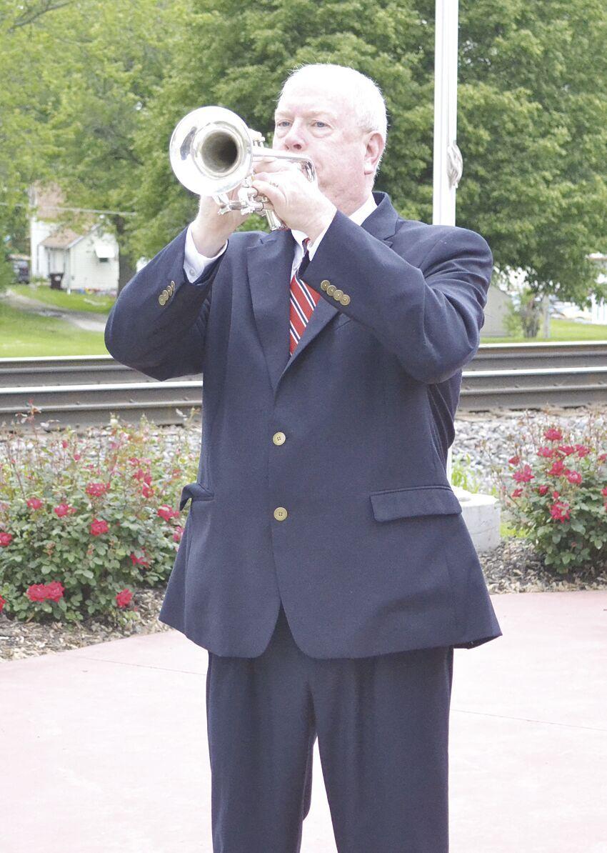 Adam Bahr playing Taps on trumpet.tif