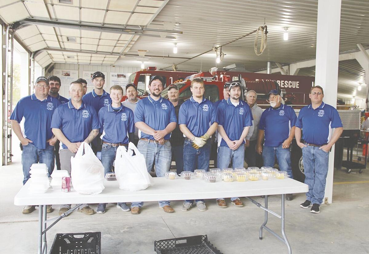 Russell Volunteer Firemen together at ham supper.tif