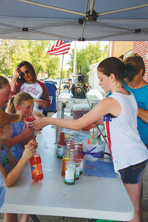 Michelle Colburn and First Baptist Church ladies handing out free snow cones