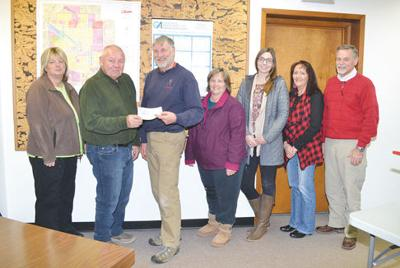 RAGBRAI Committee makes $5,800 donation to city square sidewalk project