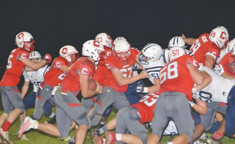 Dylan Cain runs behind offensive line