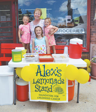 Anderson sisters raise $417 for childhood cancer through lemonade stand