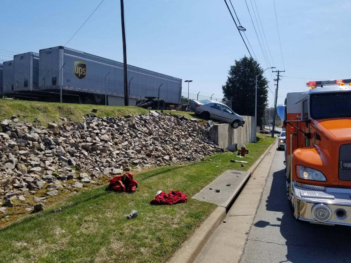 19-year-old charged after crash involving retaining wall in