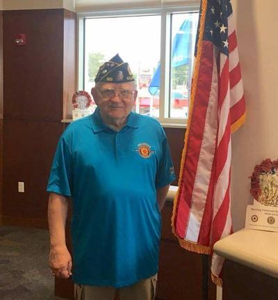 At his post: Stillwater veteran returns to leadflag salute at county meeting