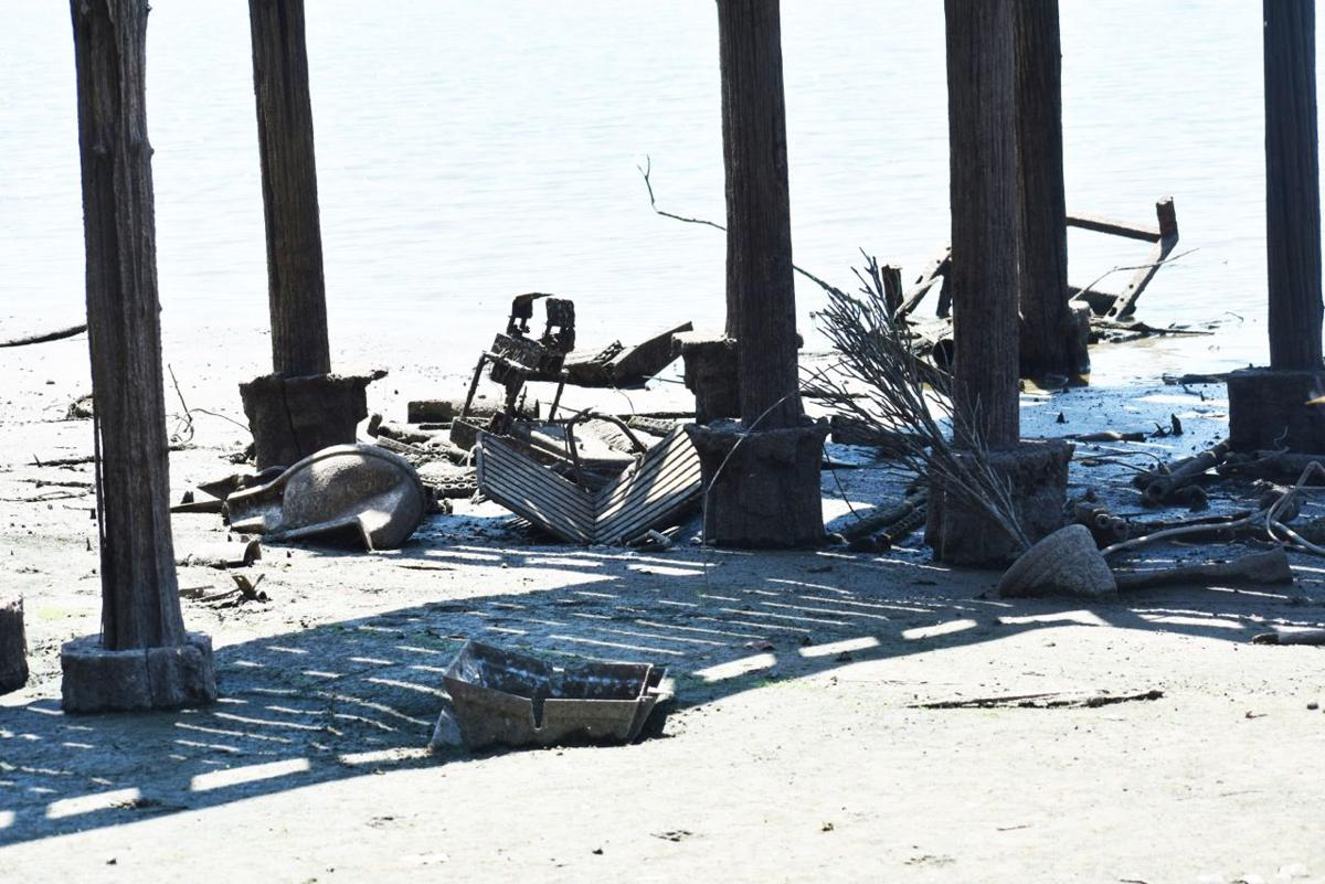 Lake docks garbage revealed after lower water levels