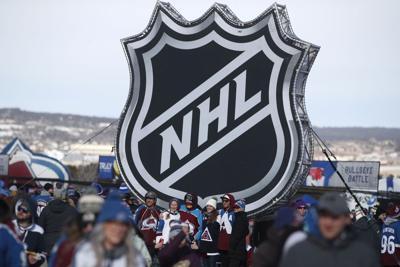 NHL logo with fans AP generi file photo
