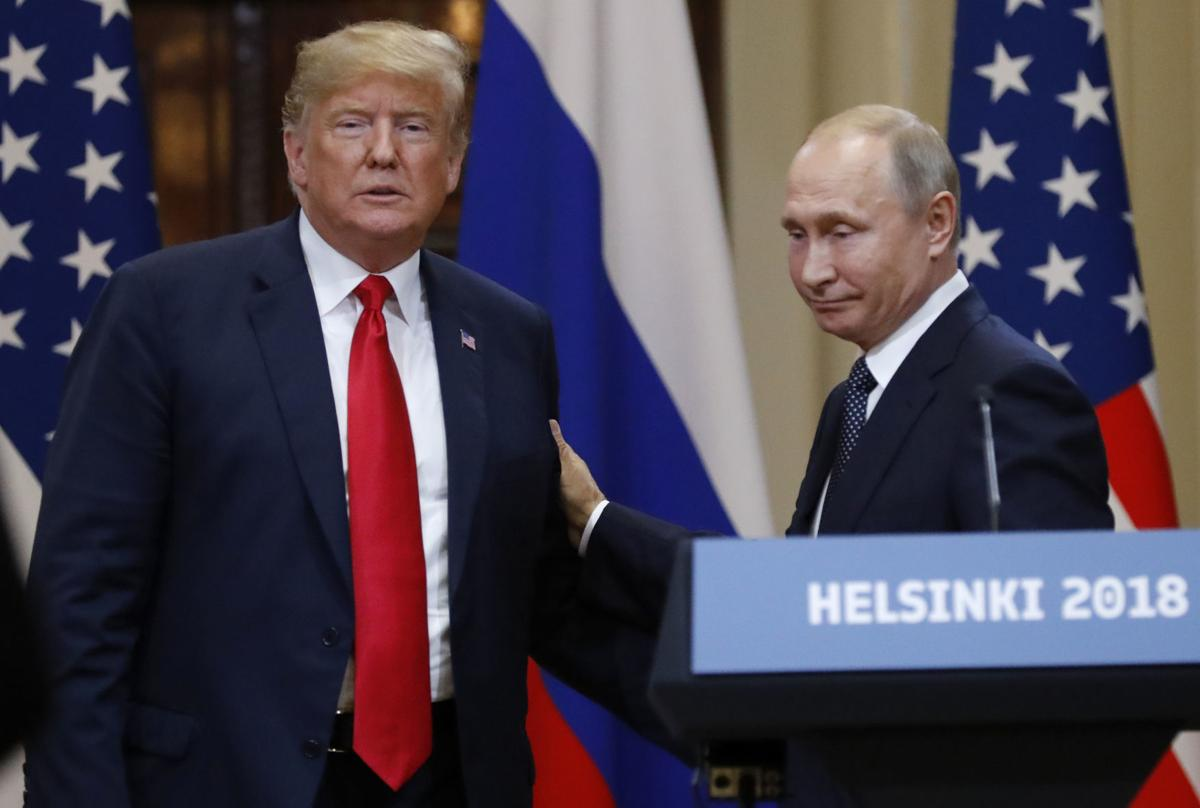 Trump embraces longtime U.S. foe Putin, doubts own intel