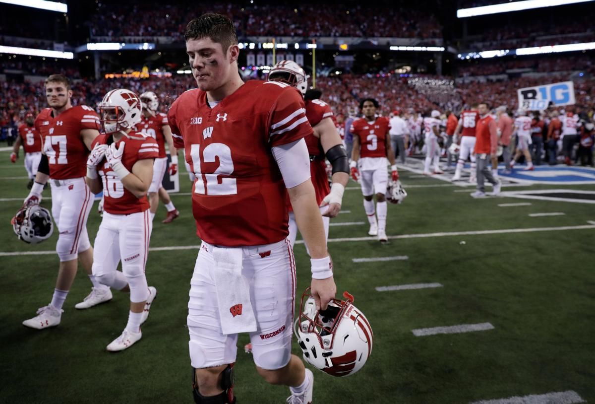 Alex Hornibrook walks off field after loss to OSU, State Journal photo