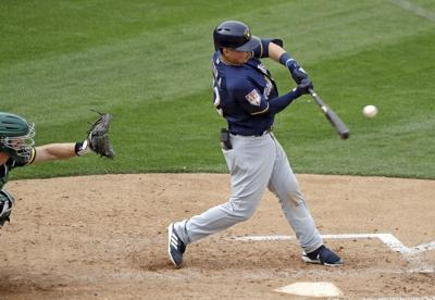 Keston Hiura homers, AP photo