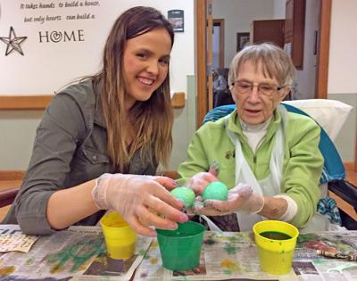 Easter egg decorating at Neighbors of Dunn County
