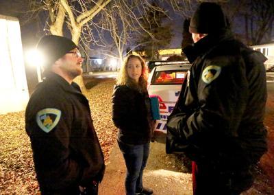 Sarah Henrickson outside with police