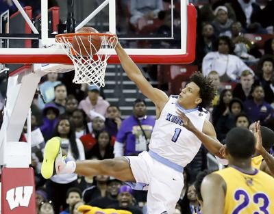 WIAA boys basketball photo: Glendale Nicolet's Jalen Johnson soars for a dunk