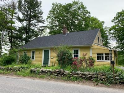 NerdWallet mortgage writer Kate Wood bought this 1740s Cape Cod-style house in late 2020. (Photo courtesy of Kate Wood)