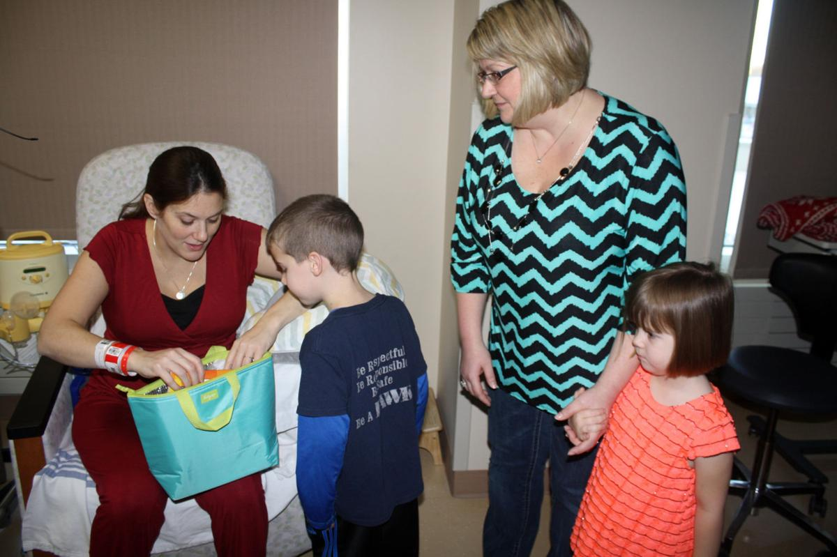 Welcome delivery: Lake Hallie family helps parents of newborns