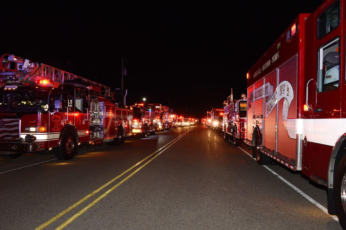 Cory Barr processional, line of fire trucks