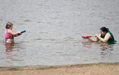 Kamryn Poling And Jennie Zimmer Enjoy A Day At The Beach Deer Creek State Park On Thursday