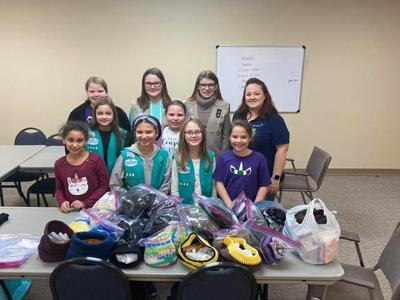 Scouts collect, donate gloves and socks for homeless
