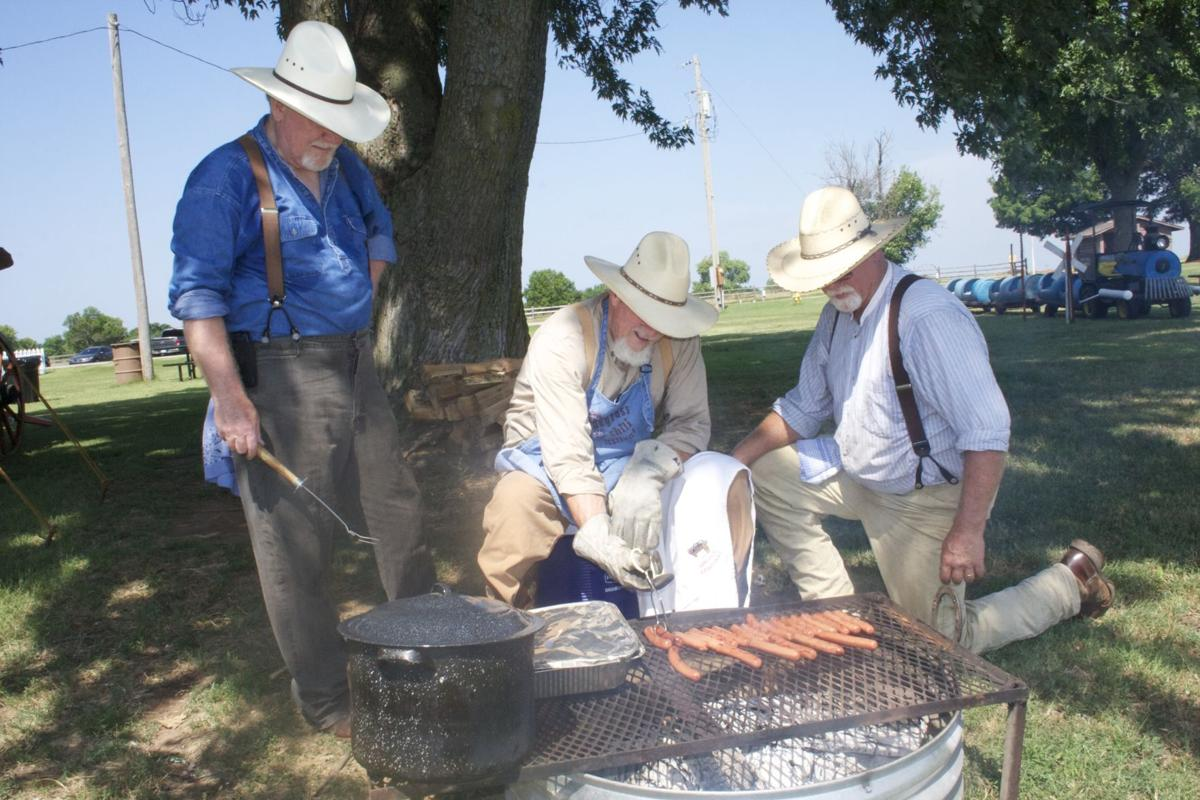 Camp fire cooking on Family Day, covered wagon gift announced