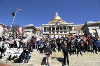 Protesting bill to ban kids tackle football