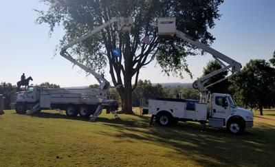 Claremore Electric and Grand River Dam Authority bucket trucks