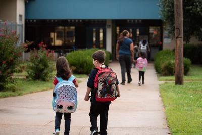Students and parents walk