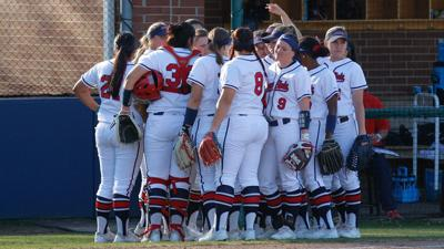 Weather forces change to softball's home opener
