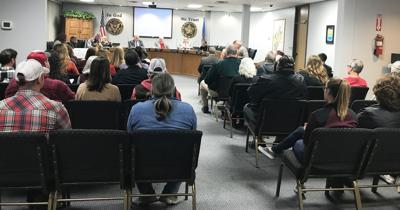 Community turns out to city council meeting to share thoughts on City Manager Jim Thomas