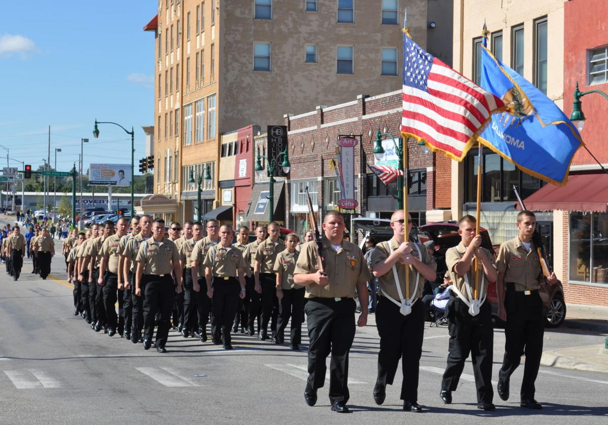 Claremore High School NJROTC cadets lead Friday's homecoming parade through  downtown Claremore.