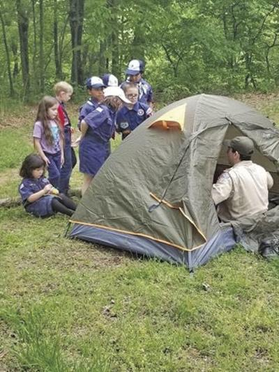 Scouts first campout packs in tent safety lessons