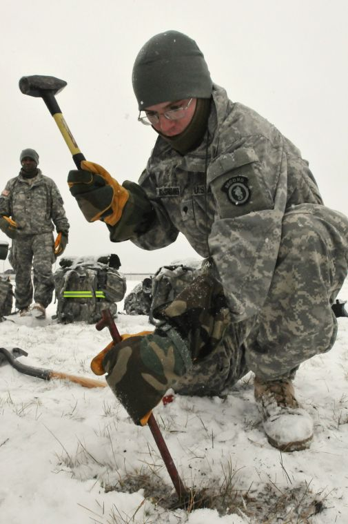 ... biological radiological and nuclear (CBRN) specialist with 472nd Military Police Company 793rd Military Police Battalion drives a tent stake ... & Fort Wainwright military police prepare for Arctic winter ...