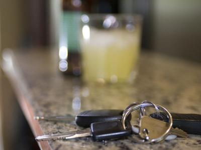 Car keys and a bottle of beer