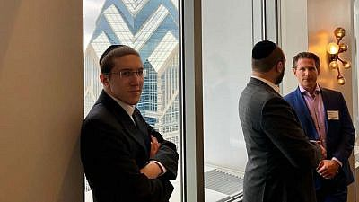 young professional minority groups in the business sector. At left is Shmuel Ben Tzvi.