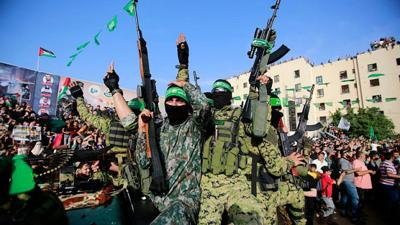 Hamas members attend a rally in Beit Lahiya