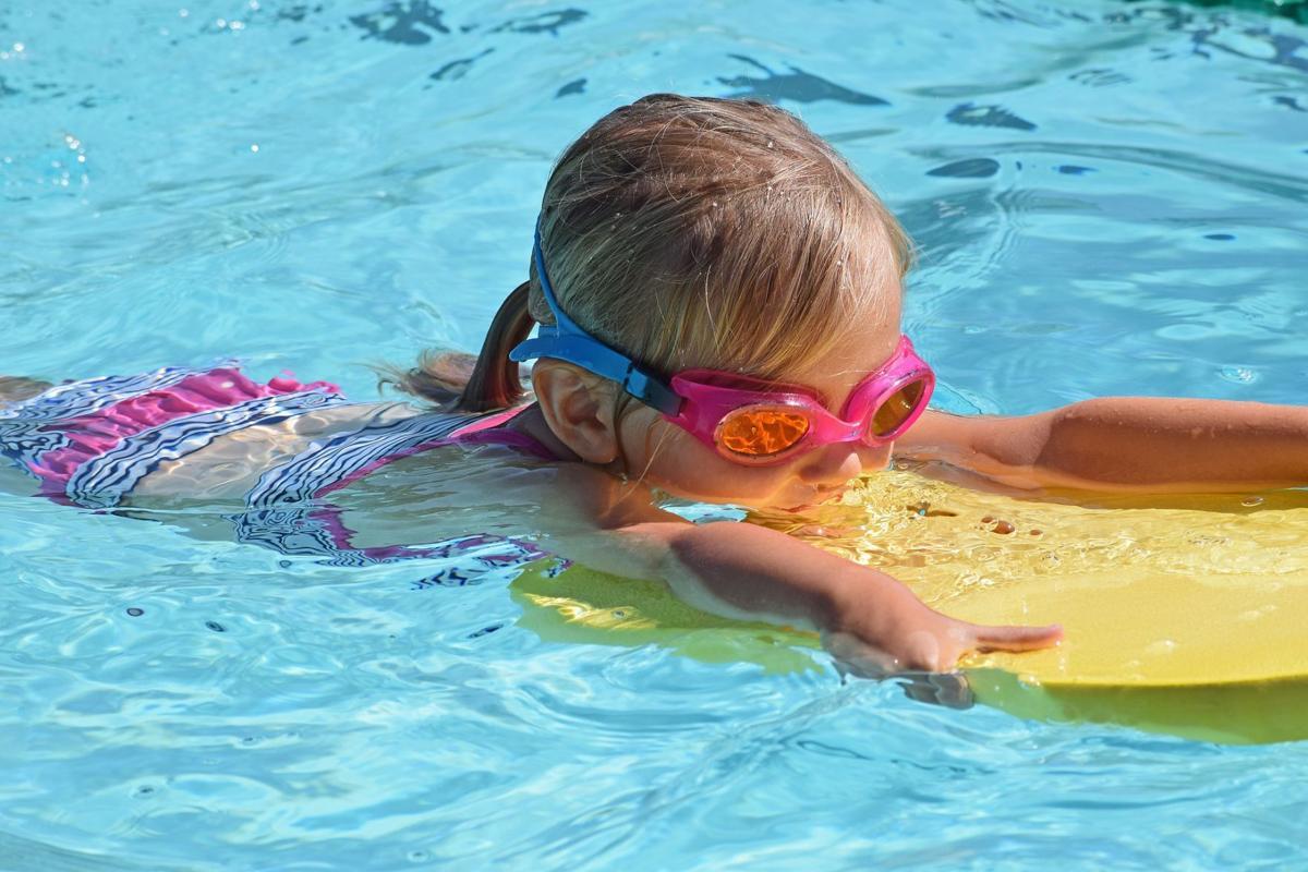stock kid swimming activity