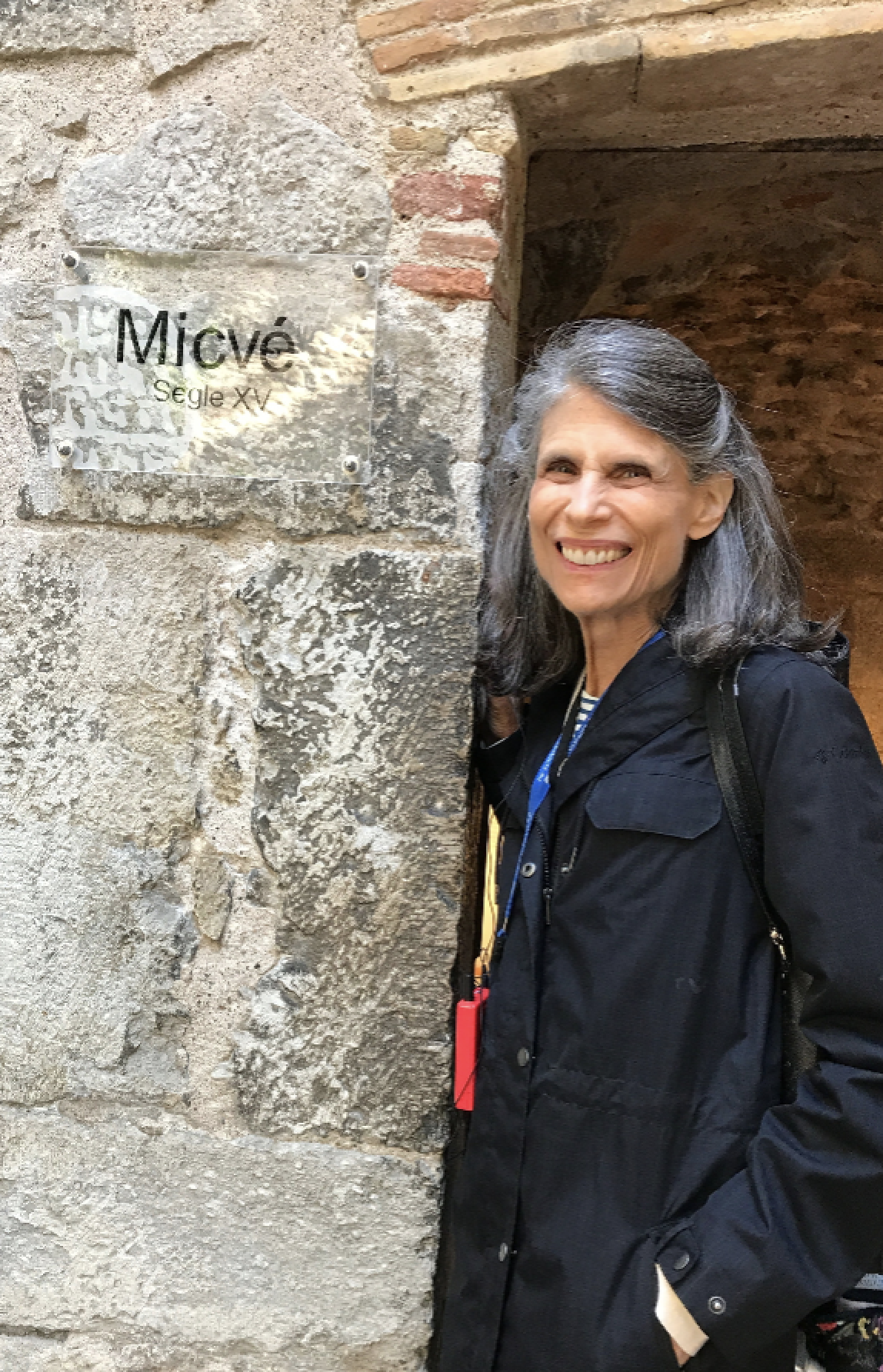 Cantor Sarah Sager stands outside a mikvah in Spain.