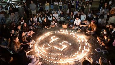 Israelis light candles for the 45 victims