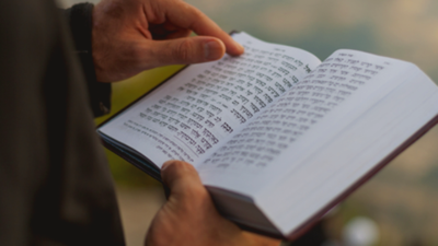 Reciting commemorative prayers from the Hebrew Bible