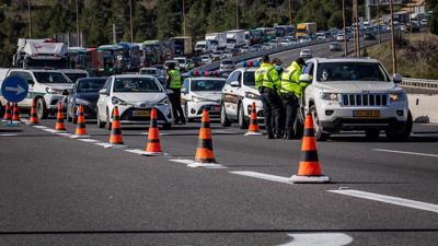 Police at a temporary roadblock outside Jerusalem