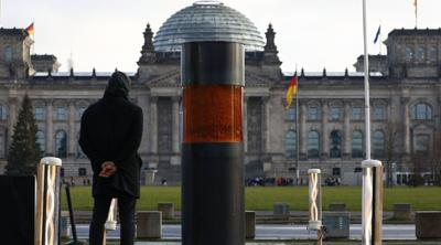 Protest urn placed near German parliament contains ashes of Holocaust victims, group says