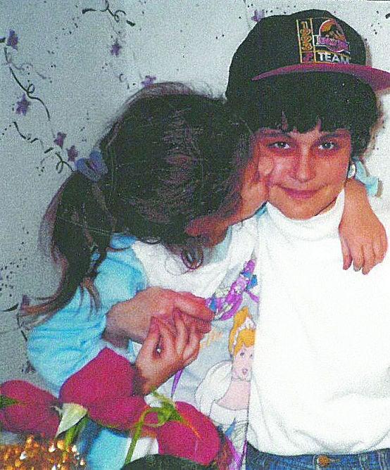 Jenn Sherman, left, kisses her mom Aliza on the cheek