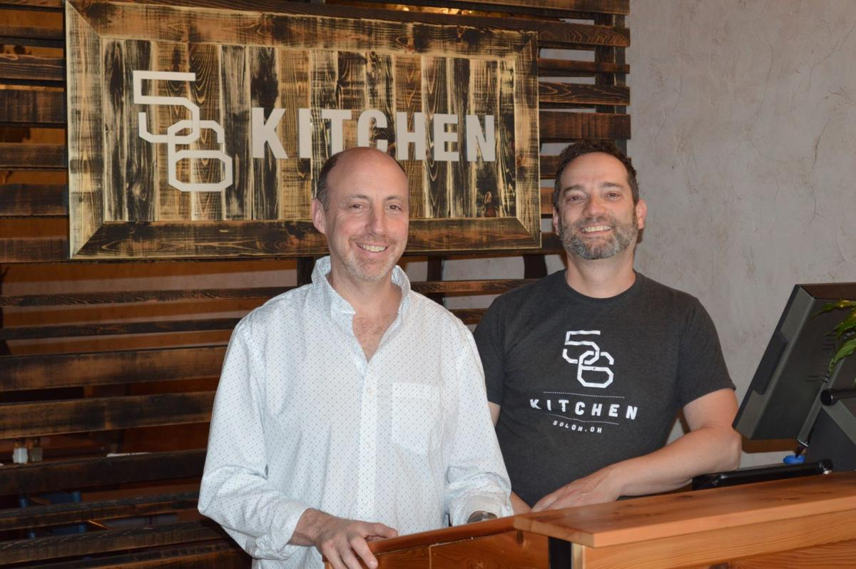 Owner jay leitson left stands next to his business partner izzy schachner at the entrance of their new restaurant 56 kitchen in solon