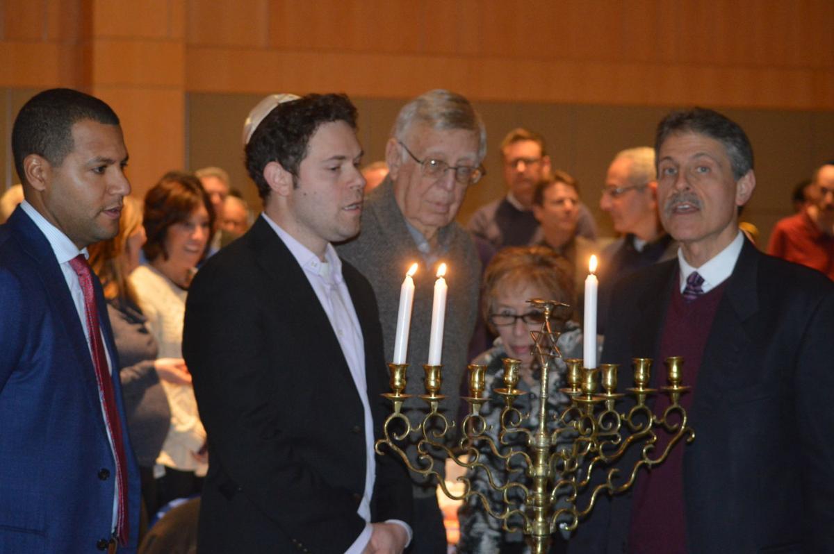 Altman lighting menorah